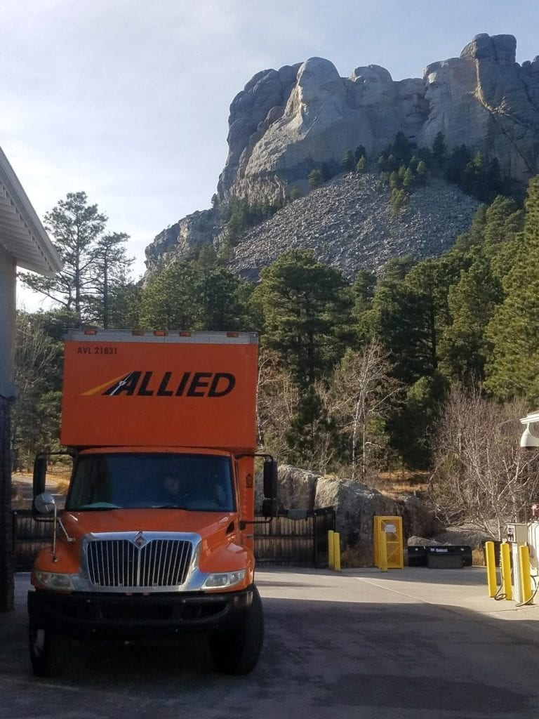 North Western Moving Company Allied Van Lines Moving Truck with Mount Rushmore in Background